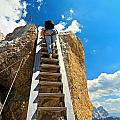 Hiker On Wooden Staircase by Antonio Scarpi