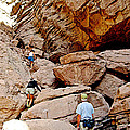 Hikers Enter Ladder Canyon From Big Painted Canyons Trail In Mecca Hills-ca  by Ruth Hager