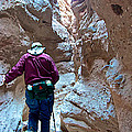 Hiking Through Narrow Slot Of Ladder Canyon Trail In Mecca Hills-ca by Ruth Hager