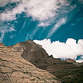 Himalyas Mountains In Tibet With Clouds by Raimond Klavins