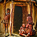 Himba Family By The Door Of Their Clay Hut by Paul W Sharpe Aka Wizard of Wonders