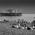 Holiday Makers On Brighton Beach by Peter Scholey