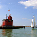 Holland Harbor Lighthouse With Sailboat by George Jones