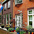 Homes Along The Canal In Enkhuizen-netherlands by Ruth Hager