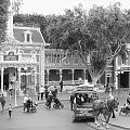 Horse And Trolley Turning Main Street Disneyland Bw by Thomas Woolworth