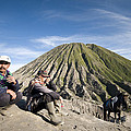 Horse Drivers Near A Volcano At Bromo Java Indonesia by Dray Van Beeck