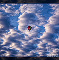 Hot Air Balloon In A Cloudy Sky Abstract Photograph by Omaste Witkowski