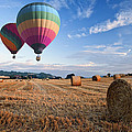 Hot Air Balloons Over Hay Bales Sunset Landscape by Matthew Gibson