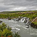 Hraunfossar Waterfall In Iceland by Patricia Hofmeester