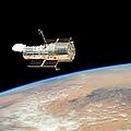 Hubble  Telescope  In  Orbit  Above  Earth by Carl Deaville