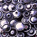Hubcaps by Eric  Schiabor