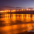 Huntington Beach Pier At Night by Paul Velgos