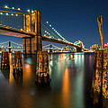Illuminated Brooklyn Bridge By Night by Mihai Andritoiu