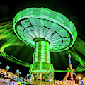 Illuminated Fair Ride With Blurred Neon by Panoramic Images
