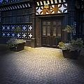 Illuminated Lamp Above The Doorway Of A Timber Framed Tudor Buil by Lee Avison