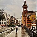 In The Rain - Puente De Triana by Mary Machare