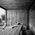 Interior End Of Porch With Vertical Louvers by P.A. Dearborn