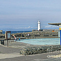 Irish Sea Lighthouse On Pier by Brenda Brown