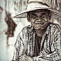 Isaan Rice Farmer by Ian Gledhill