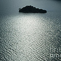 Lugu Lake Island And Ripples China by James Brunker