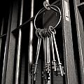Jail Cell With Open Door And Bunch Of Keys by Allan Swart