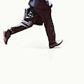 Japanese Businessman Walking Fast by Ron Koeberer