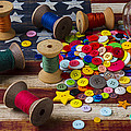 Jar of buttons and spools of thread by Garry Gay
