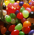 Jelly Beans Spilling Out Of Glass Jar by Anonymous
