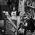 Jesus With Arms Wide Open Religious Figurines In A Shop Window In Toronto by Randall Nyhof