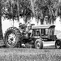 John Deer Tractor Under The Old Cedar by Scott Hansen