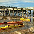 Kayaks By The Pier by Adam Jewell