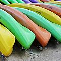 Kayaks In A Row by Chuck  Hicks