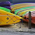 Kayaks Stacked by Chuck  Hicks