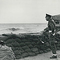 Keeping Watch On The High Tides At Lyn Mouth by Retro Images Archive