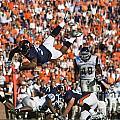 Keith Payne Superman Dive Virginia Cavaliers Football by Jason O Watson