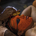 Kerala - A Theyyam-dancer Receives The Ornamental Face-painting by Urs Schweitzer