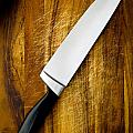 Knife On Chopping Board by Tim Hester