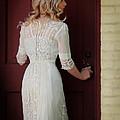 Lady In Edwardian Dress Opening A Door by Jill Battaglia