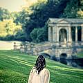 Lady Sitting On A Hill Above A Lake by Jill Battaglia