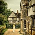 Lady Walking In The Village by Jill Battaglia