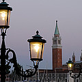 Lampposts Lit Up At Dusk With Building by Panoramic Images