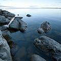 Landscape Of Rocks Along Shoreline by Woods Wheatcroft