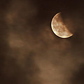 Last Stage Of The Total Lunar Eclipse April 15 Blood Moon Through The Clouds by Eti Reid
