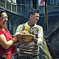 Laughing Couple Doing Puja by Karma Ganzler