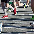 Legs Of Runners At Marathon by Jannis Werner