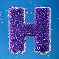 letter H underwater with bubbles  by Dmitriy Lokash