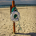 Life Preserver On The Beach In Pentwater Michigan by Randall Nyhof