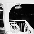 lifebelt on board the hurtigruten ship ms midnatsol at night in winter in Tromso troms Norway by Joe Fox