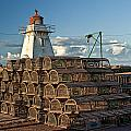 Lighthouse On A Channel By Cascumpec Bay On Prince Edward Island No. 094 by Randall Nyhof