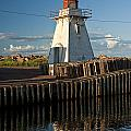 Lighthouse On A Channel By Cascumpec Bay On Prince Edward Island No. 095 by Randall Nyhof
